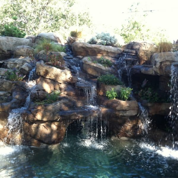 A water feature that has streams running down into a pond located in Muenster Texas.