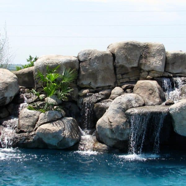A water feature that has a slide that flows into the pool. Muenster Texas.