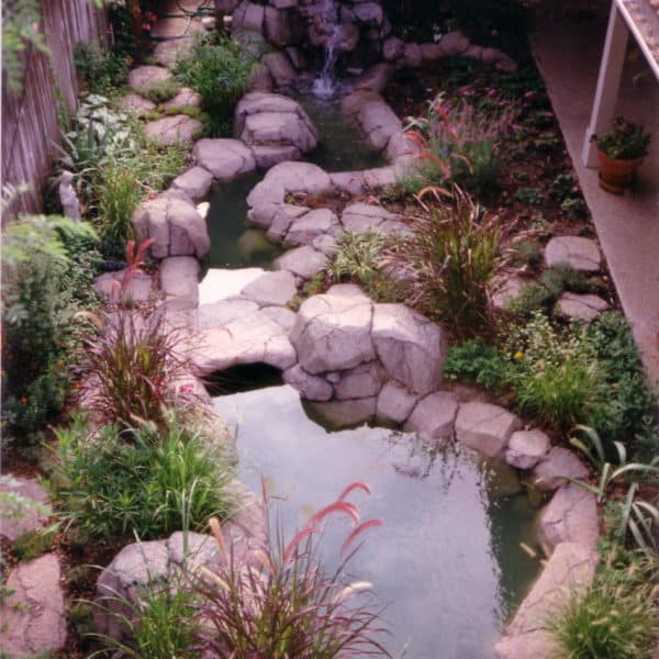 A koi pond in Fort Worth Texas made out of artificial rock.